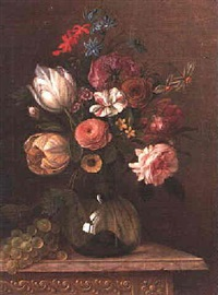 a still life of tulips, narcissi, roses and other flowers in a glass vase beside grapes on a marble ledge by martin van dorne