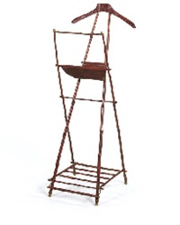 a foldable leather, brass, bamboo and wood valet, 1950s by jacques adnet