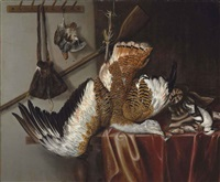 a great bustard and a partridge suspended from strings, with a smew and three songbirds on a partially draped table, with a rifle and hunting bag... by jacobus biltius