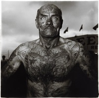 tattooed man at a carnival, m.d by diane arbus