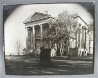 belle grove plantation with tree stump in foreground, white castle, louisiana by walker evans