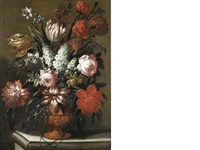 roses, tulips, lilies and other flowers in a terracotta vase on a stone ledge by gaspar pieter verbruggen the elder