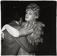 two men dancing at a drag ball, n.y.c by diane arbus