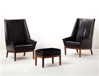 pair of high-backed lounge chairs and one ottoman by erik andersen