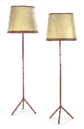 a pair of leather and metal floor lamps, 1950s by jacques adnet