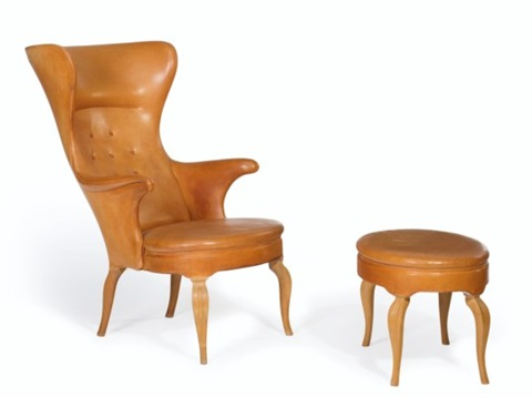 A High Back Chair And Ottoman By Frits Henningsen