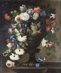 tulips, peonies, jasmine and other flowers in a classical carved stone urn, before an open landscape; and roses, carnations, convolvulus and other flowers in a classical carved stone urn, on a table (pair) by francesco della questa