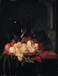 still life of a roemer and a wine glass together with cherries, peaches, grapes, redcurrants, oranges and a lemon, arranged on a silver plate on a wooden ledge draped with a green cloth by jacobus van der hagen