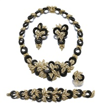 parure comprising a necklace, a bracelet, a pair of ear clips and a ring en suite (set of 4) by adler