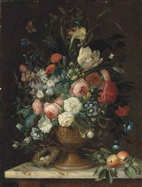 roses, tulips, carnations, morning glories, irises and other flowers in a relief vase, a bird's nest with eggs and peaches on a marble topped table, with a peacock butterfly, a brimstone, a bumble-bee and other insects by jan van os