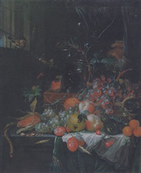 grapes in a basket, a corn cob, various fruit, a roemer and a wine flute on a chest, a lit taper on a draped stone ledge and a chaffinch in a window by catharina treu