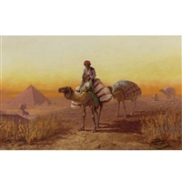 a caravan passing by the pyramids of giza by f. percy