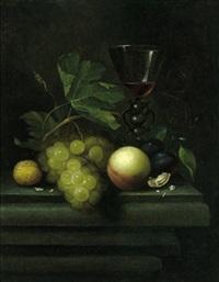 stillleben mit weintrauben, einem pfirsich, nüssen und einem gefüllten, venezianischen weinglas by johannes borman