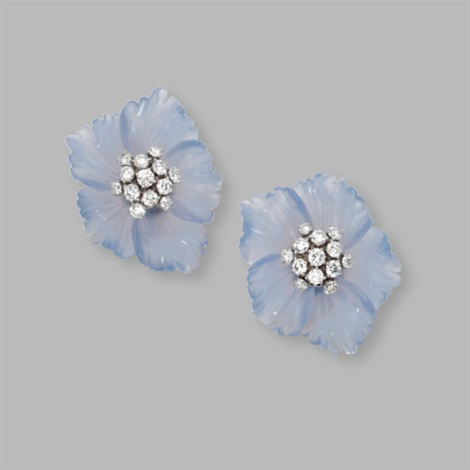 a pair of earclips designed as flowerheads by aletto brothers co