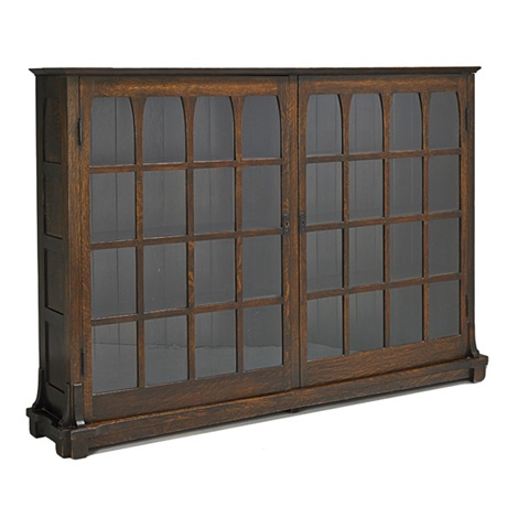 two door bookcase with mitered mullions and cathedral arches by gustav stickley