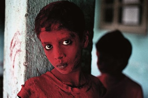 red boy during holi festival by steve mccurry
