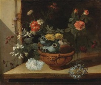 still life with various flowers and a ceramic vase balanced in a clay pot resting on a stone ledge by niccolino van houbraken