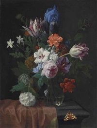 hibiscus, parrot tulips, carnations, a rose, an iris, snowballs and other flowers in a vase on a partially draped stone ledge, with a garden tiger moth by nicolaes van veerendael