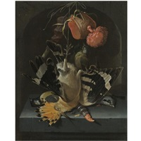 still life with a hoopoe, a great tit, a falconry hood and a decoy whistle all arranged within a stone niche by abraham mignon