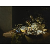 still life of hazelnuts, grapes, oysters and other foods on a draped table by laurens craen