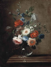 roses, a tulip, corn flowers, a lilly and hollyhocks in a glass vase on a stone ledge by karel van vogelaer