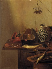 a kitchen still life with fish by reynier covyn