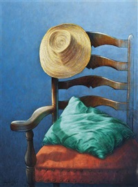 straw hat and a cushion on a chair by guy gladwell
