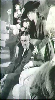 ejected man in chair, woman conforting him by g. patrick nelson
