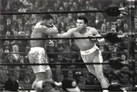 muhammad ali returns to the ring to lose, in a unanimous decision, to joe frazier by robert riger