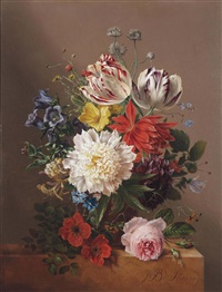 tulips, roses, peonies and other flowers in a vase on a stone ledge by maria geertruida snabilie