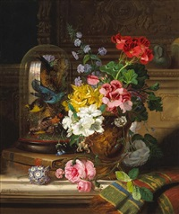 a still life with pelargoniums, roses and other flowers in a terracotta urn, songbirds in a glass dome, books and a carpet, all resting on a table by john wainwright