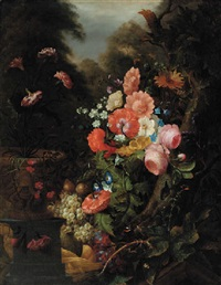 roses, carnations, poppies and other flowers by a tree trunk, with carnations in a sculpted flower pot and grapes and other fuits in a basket, in a garden by pieter gallis