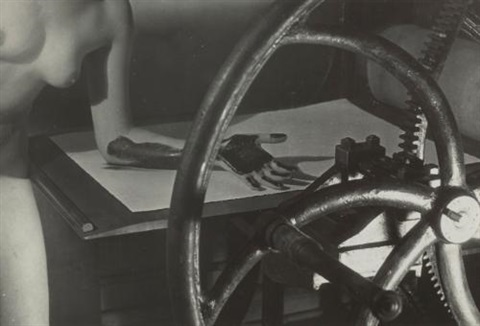 meret oppenheim at the printing wheel by man ray