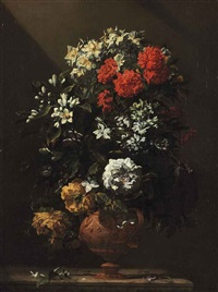 roses and other spring flowers in a vase on a stone ledge by jean-michel picart