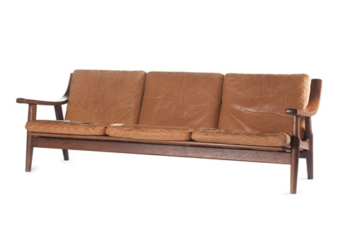 An Ottoman ge 530 couch, two easy chairs and an ottomanhans j. wegner on