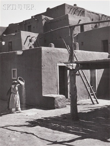 winnowing grain taos pueblo new mexico by ansel adams