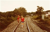 untitled (two boys walking on railroad tracks) by william eggleston