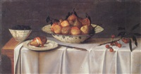 still life of pears in a blue and white porcelain bowl, two pears on a porcelain dish, a bowl of blackberries and a sprig of cherries by gijsbert van glabbeeck