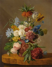 flowers in a vase on a marble ledge by anthony oberman