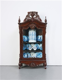 armoire (22 delft saw blades and 1 gas canister in) by wim delvoye