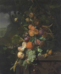 peaches, apricots, plums, grapes and other fruit, ears of corn, hazelnuts and a walnut on a plinth with a sculpted relief, with an admiral, a dragonfly and other insects in a wooded landscape by jan mortel