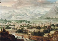 a river landscape with a town, mountains beyond by herri met de bles