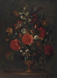 flowers in a vase on a marble ledge by gaspar pieter verbruggen the elder