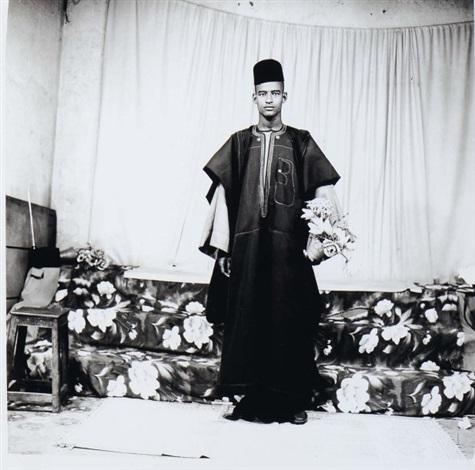 un jeune homme debout un pot de fleurs au bout du bras by cornélius yao august azaglo