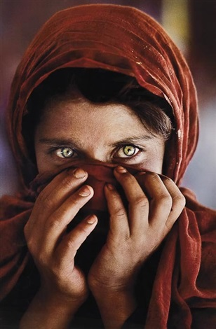 afghan girl with hands on face by steve mccurry