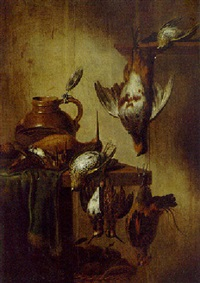 a dead partridge, snipe, woodcock, and other birds with a flask and walnuts on a table by petrus schotanus
