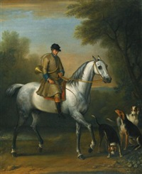 a huntsman on a grey hunter with hounds in a landscape by john wootton