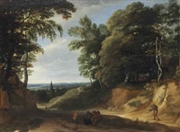 a wooded landscape with figures on a path, a village beyond by lodewijk de vadder