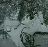 femme au rocking-chair dans un jardin by juan (jean) sala gabriel