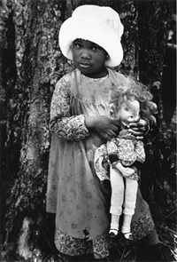 young child with doll (from the film the color purple) by gordon parks